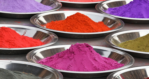 Different coloured paint powder in bowls